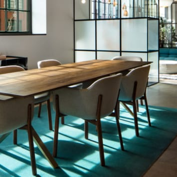 modern dining room table and chairs at the studio como denver showroom