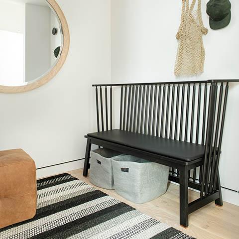 modern entry way featuring a de la espada low settle bench