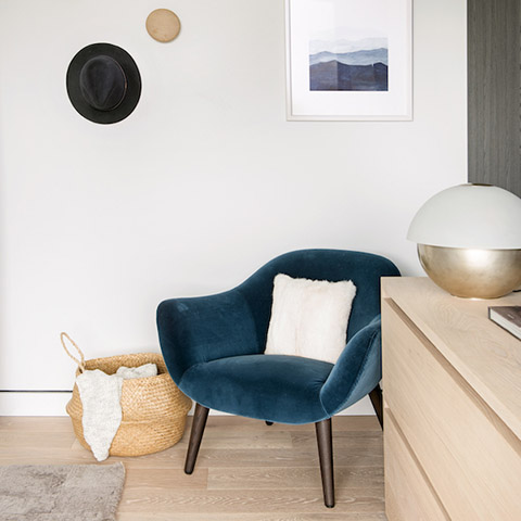 modern bedroom featuring a poliform mad chair in blue velvet