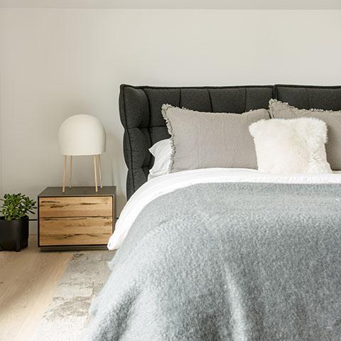 modern bedroom featuring a b&b italia husk bed