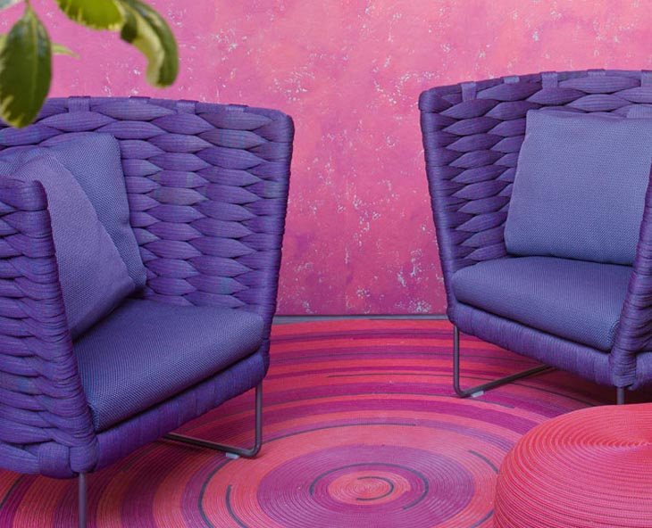 outdoor patio featuring paola lenti ami armchairs in purple