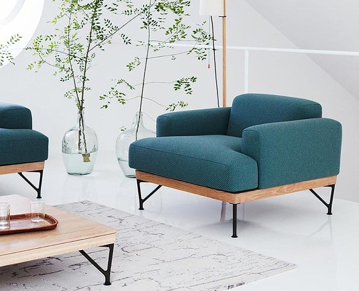 modern living room featuring armstrong armchair by de la espada