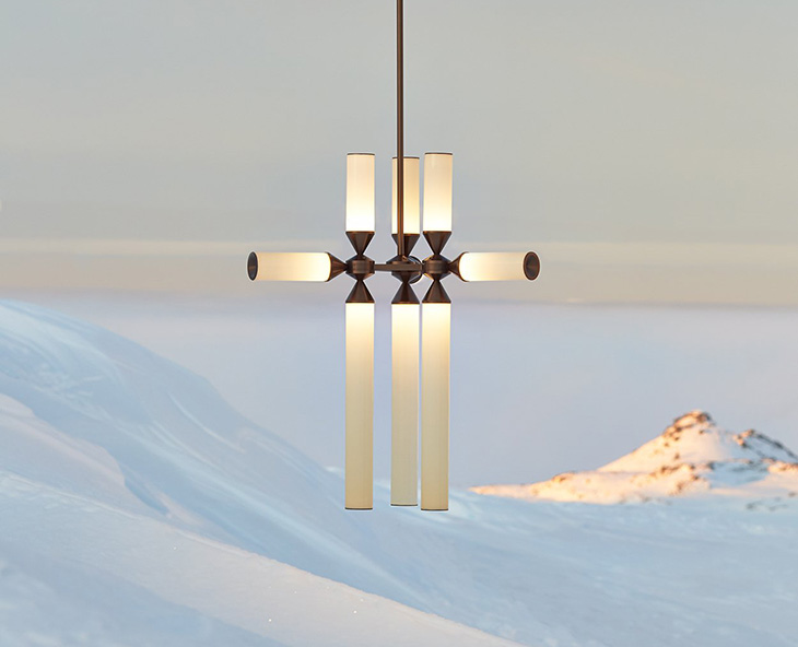 roll & hill castle pendant displayed against a snowy backdrop