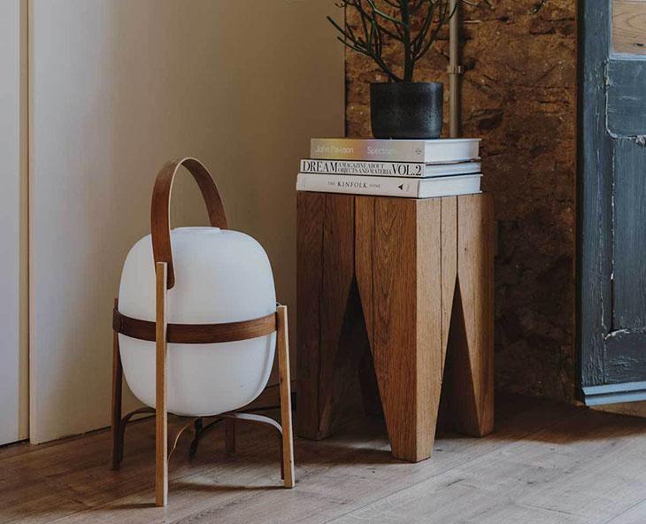 entryway featuring e15 backenzahn stool and santa & cole cesta lamp