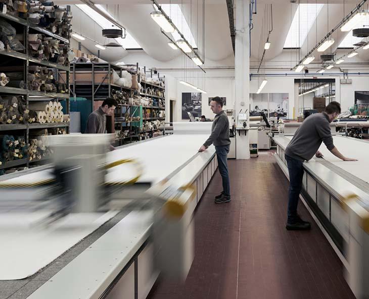 craftsmen working in the flexform factory in italy