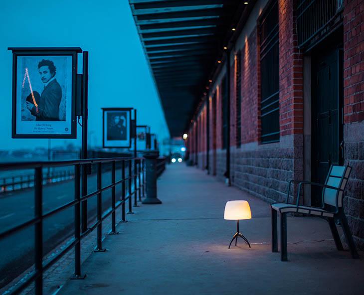 outdoor train platform featruing foscarini lumiere table lamp