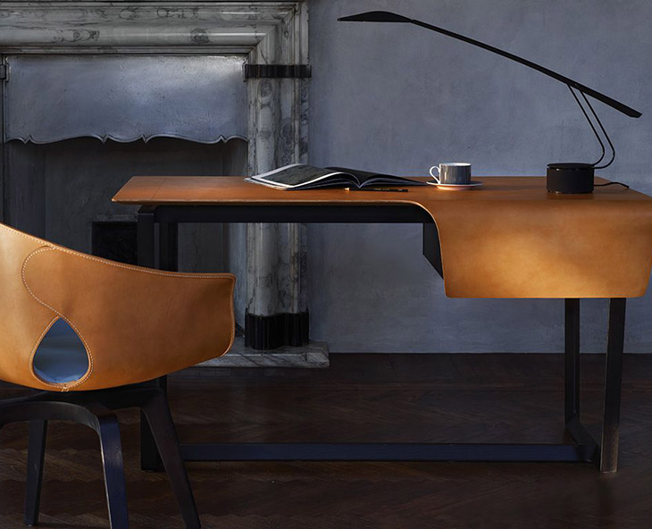 home office space featuring poltrona frau fred desk