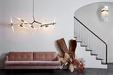 roll & hill headquarters featuring agnes chandelier