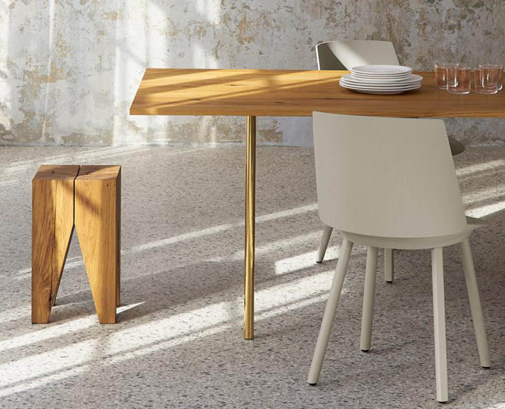 modern dining room featuring e15 backenzahn stool and houdini chair