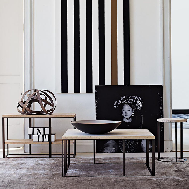 three b&b italia lithos tables with stone tabletops styled with original artwork