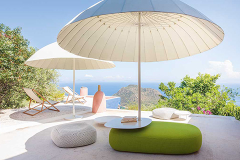 paola lenti clique parasols on the deck of an ocean front property