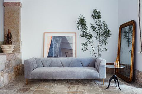 living room featuring de la espada gates sofa