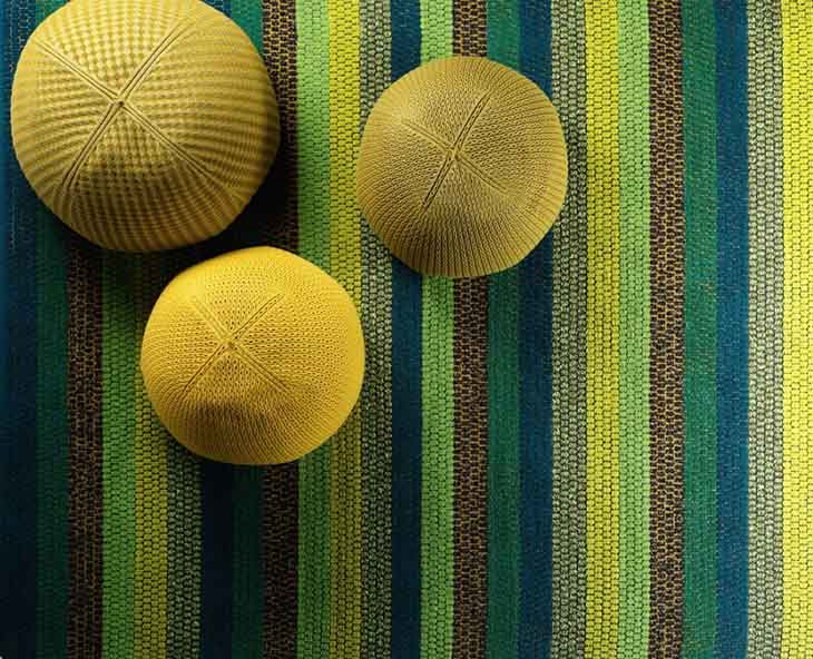 detail of kasthall happy rug in green, yellow, and blue stripes