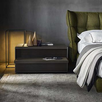 modern bedroom featuring b&b italia husk bed