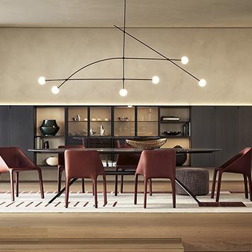 modern dining room featuring poliform furniture