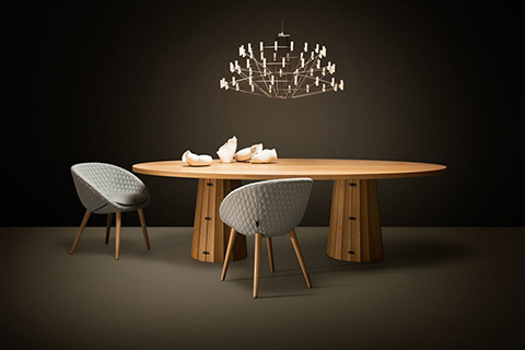 dining room vignette featuring moooi table, chairs, and chandelier
