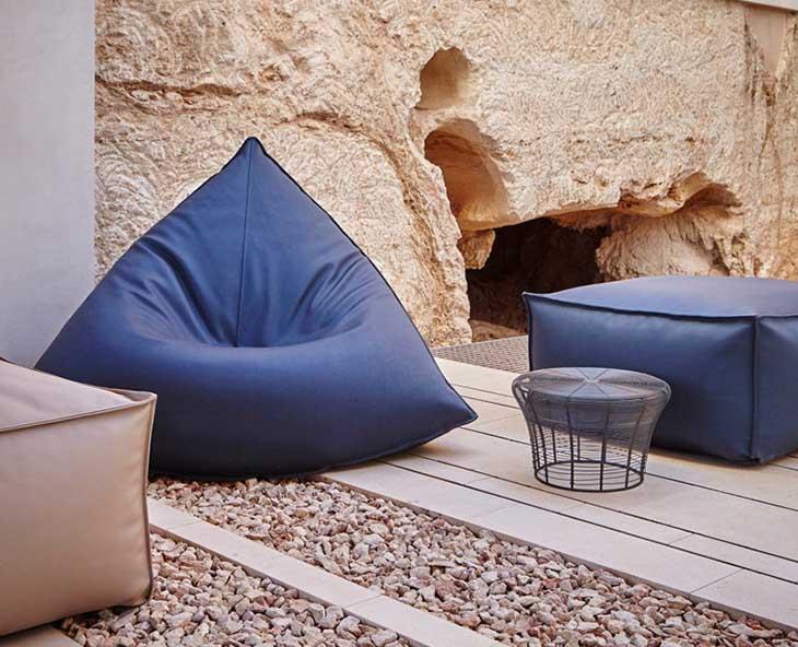 outdoor patio featuring gandia blasco sail armchair and poufs