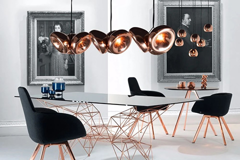 dining room featuring copper scoop and void pendant lights by tom dixon