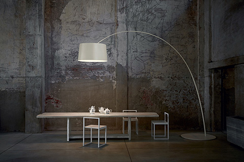 dining room featuring foscarini twice as twiggy floor lamp