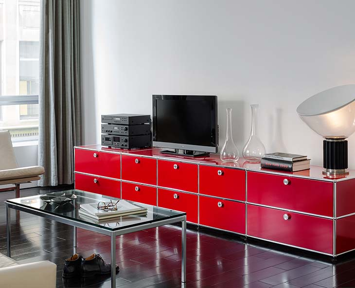 living room featuring a red usm media console
