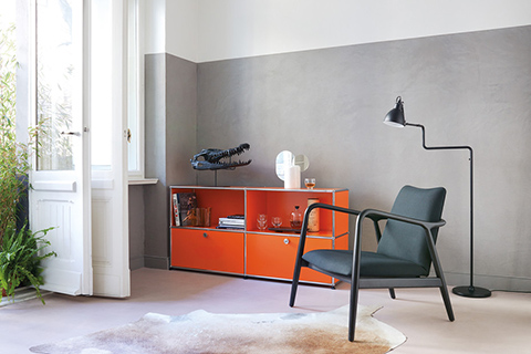 living room featuring orange usm storage unit