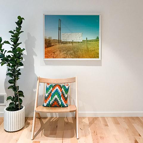 art by jamie kripke hanging in a sparse room