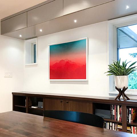 art by jamie kripke hanging in a modern office