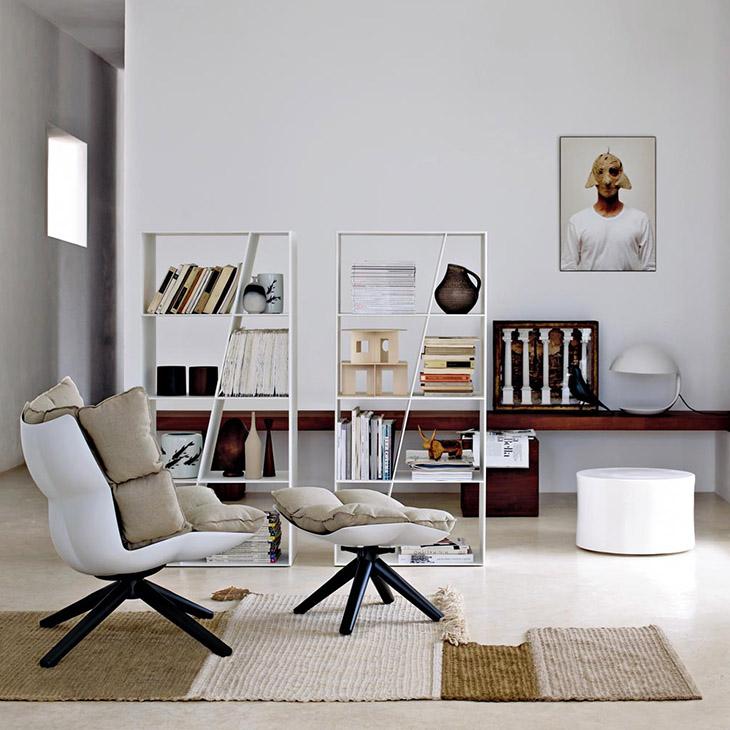 modern living room featuring b&b italia husk armchair and ottoman with wood base