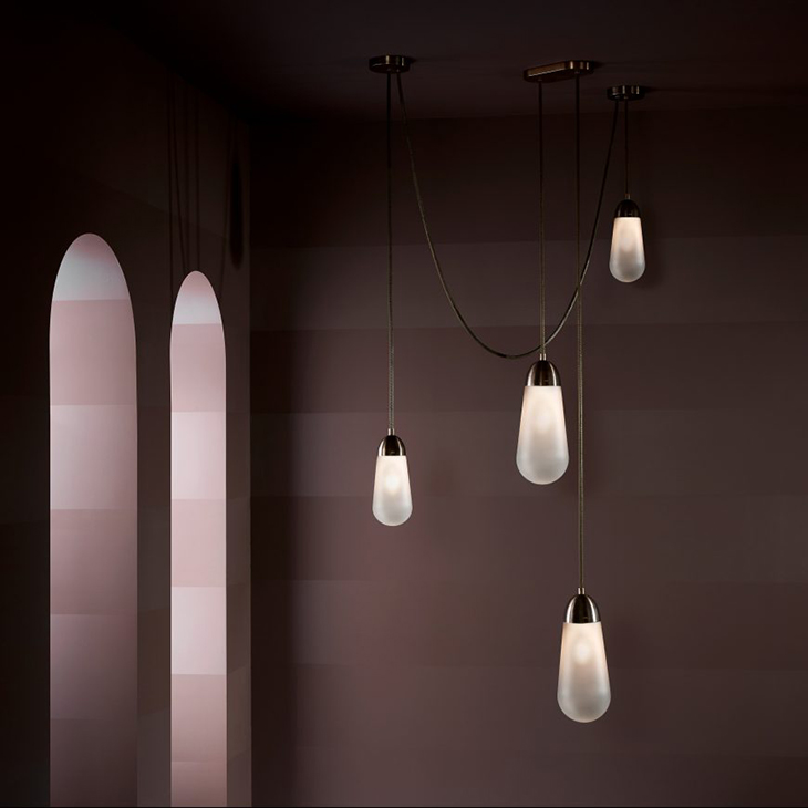 apparatus lariat pendant light in room with two arched doors