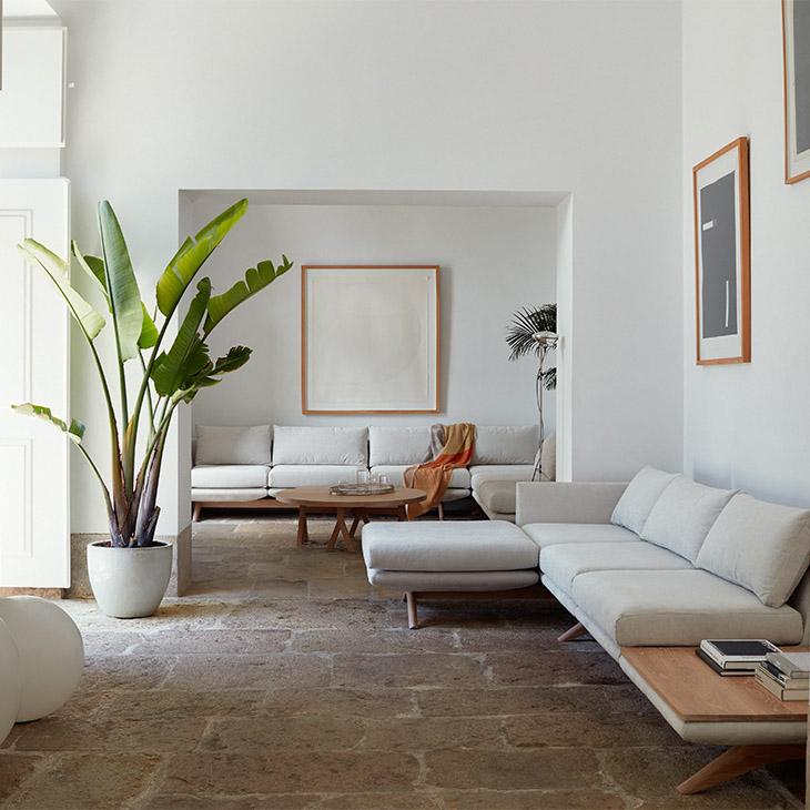 white living room featuring de la espada sofas and coffee table