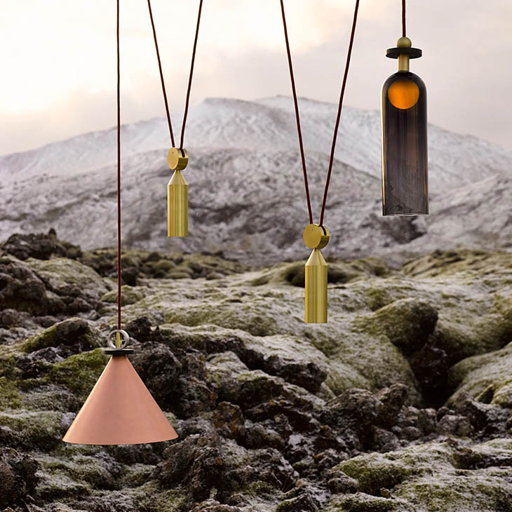 roll & hill shape up pendant in an outdoor setting near volcanic rock and mountains