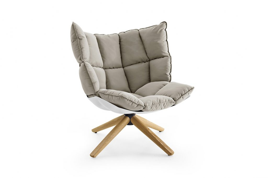 b&b italia husk armchair with wood base on a white background