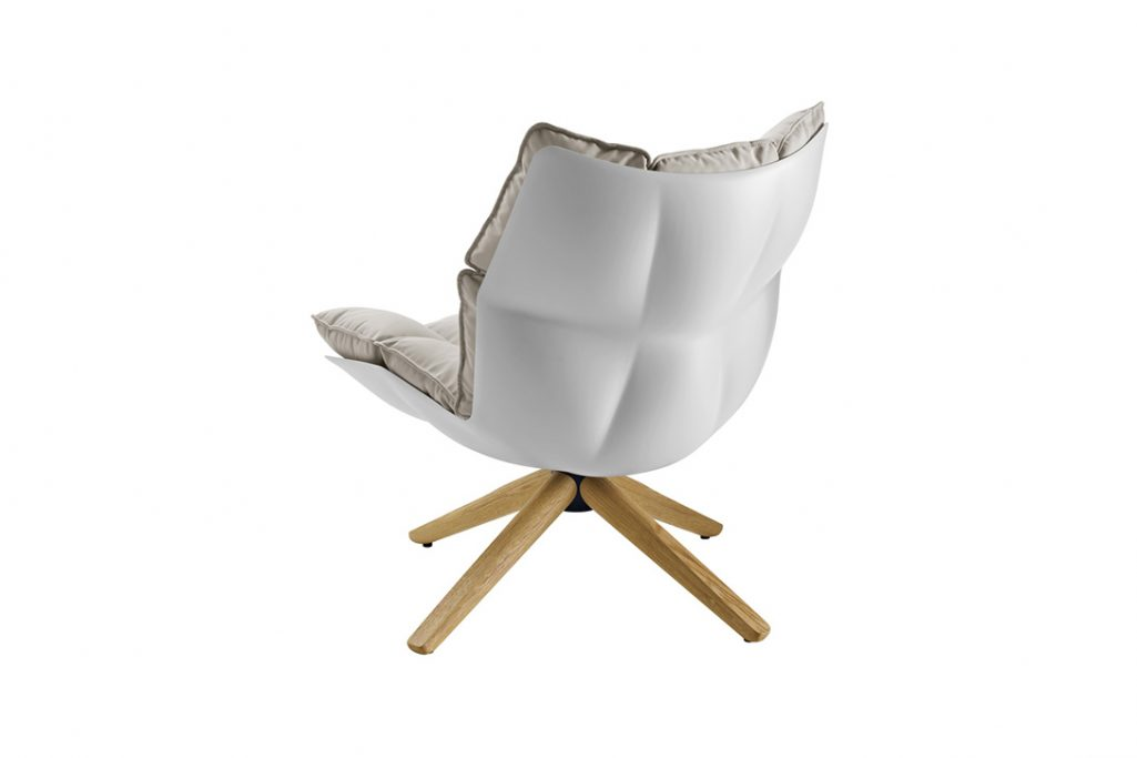 shell of a b&b italia husk armchair with wood base on a white background