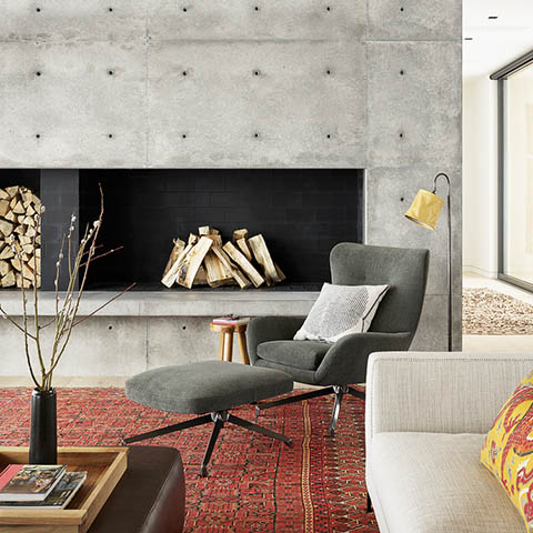 modern living room in jackson wyoming featuring a minotti jensen bergere and ottoman
