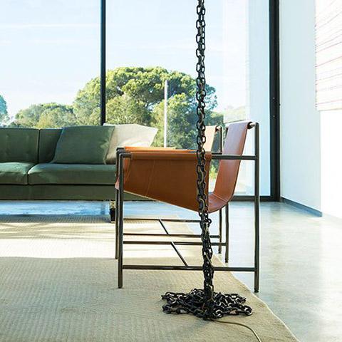 modern living room featuring a poltrona frau ming's heart armchair