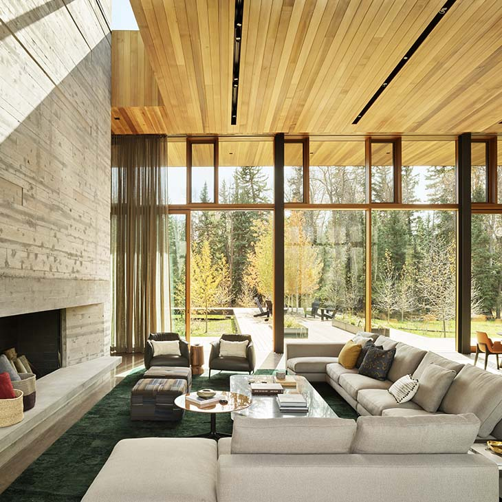 modern house in jackson wyoming featuring a minotti andersen sectional sofa