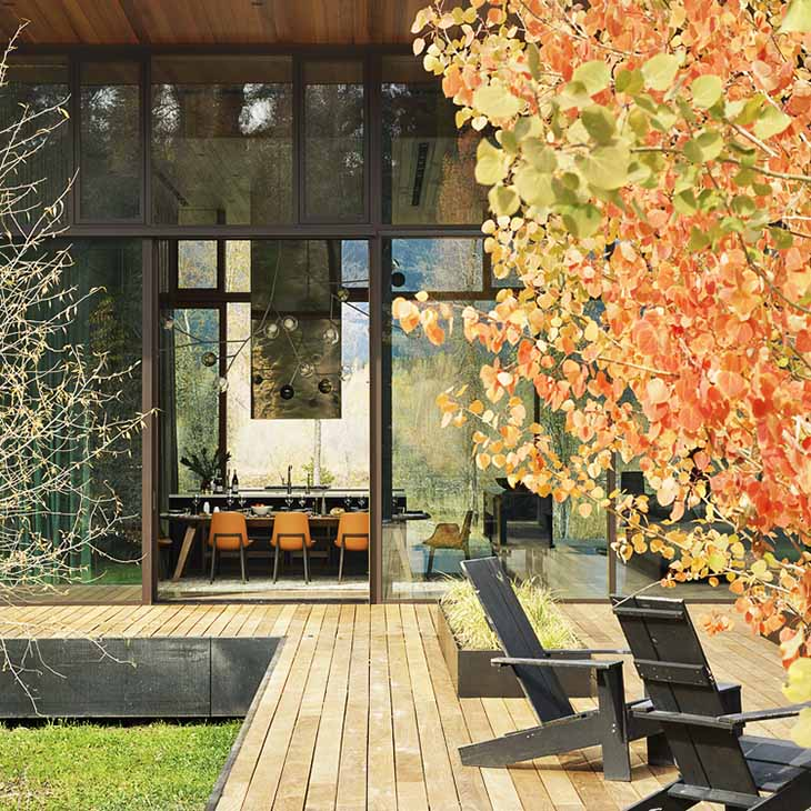 modern house in jackson wyoming featuring a De La Espada Together table and six Poliform Ventura chairs