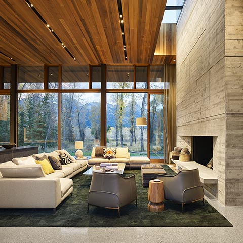 modern house in jackson wyoming featuring two poltrona frau archibald armchairs