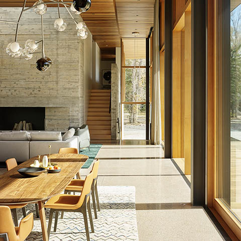 modern house in jackson wyoming featuring a custom bocci pendant