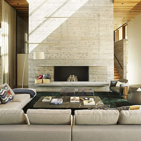 modern house in jackson wyoming featuring a poliform mondrian coffee table