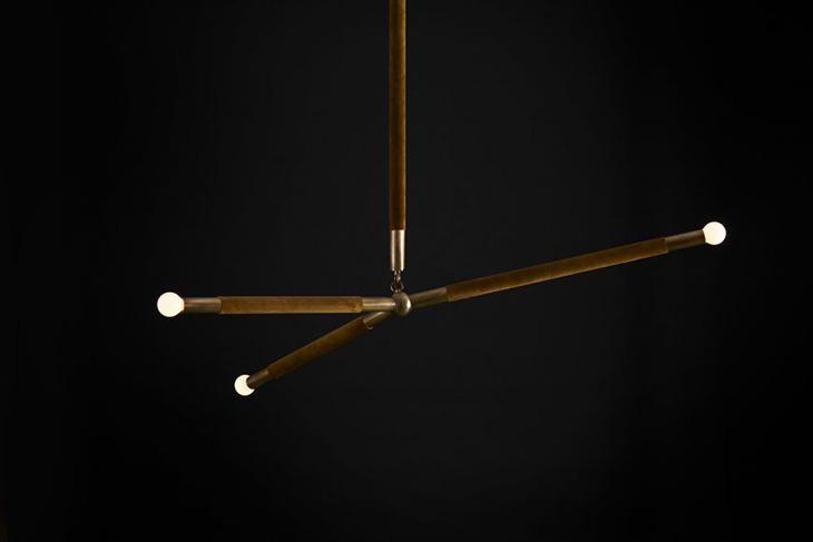 apparatus arrow pendant with leather wrap on a black background