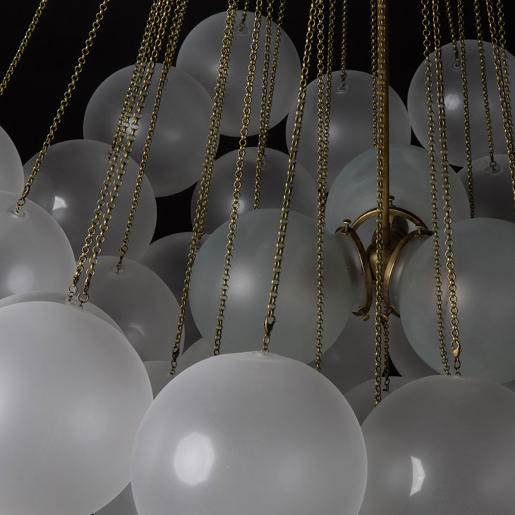 close up of the orbs on an apparatus cloud pendant