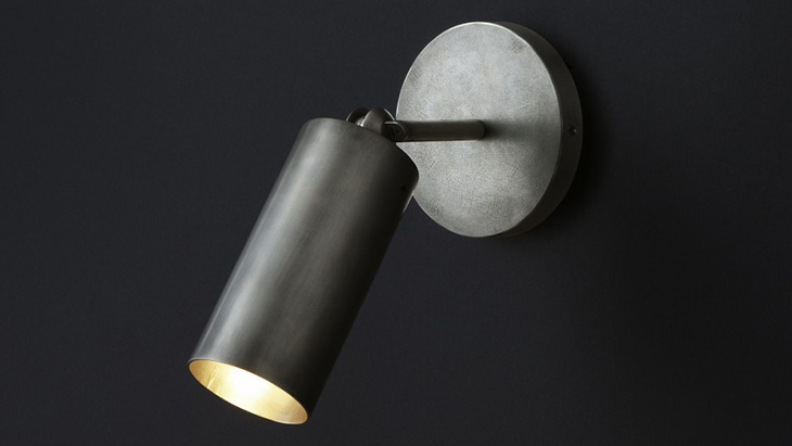 apparatus cylinder sconce on a black background