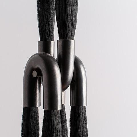 close up of an apparatus horsehair pendant light
