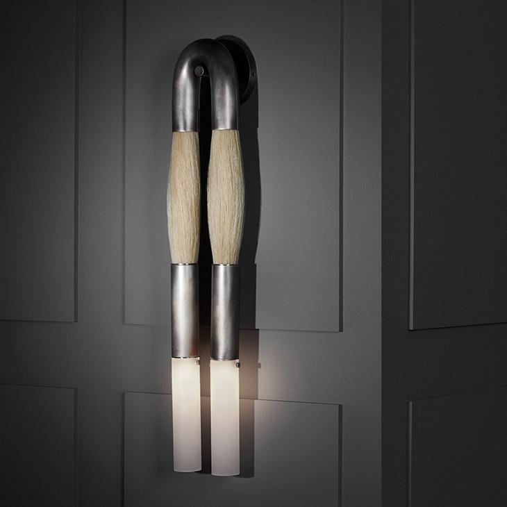 apparatus horsehair sconce in a dark room