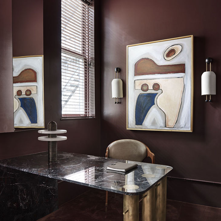 modern art deco office featuring apparatus lantern sconces and median table lamp
