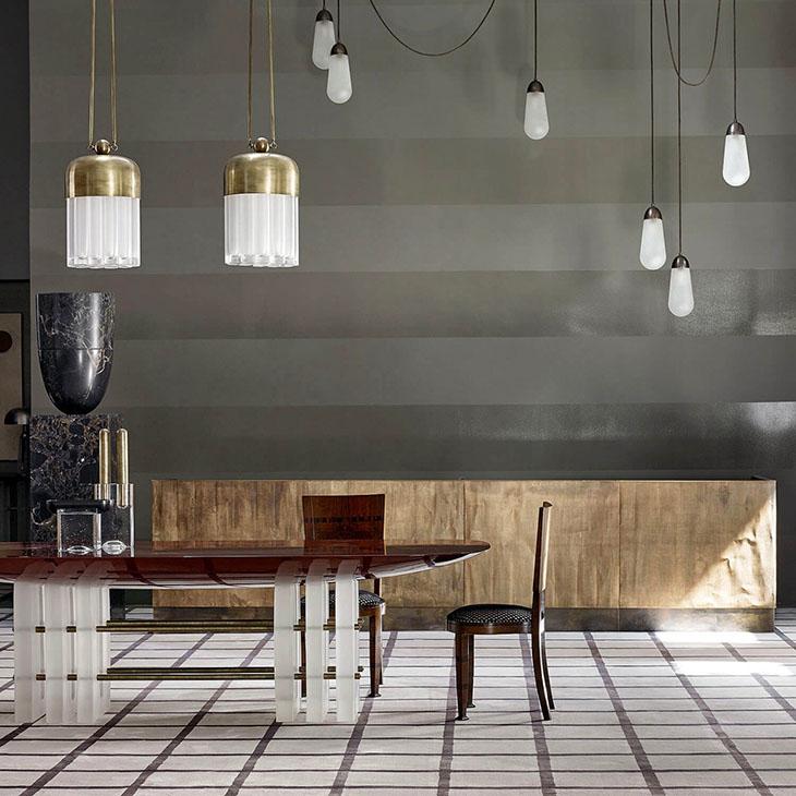 modern room featuring apparatus lariat pendant light installation