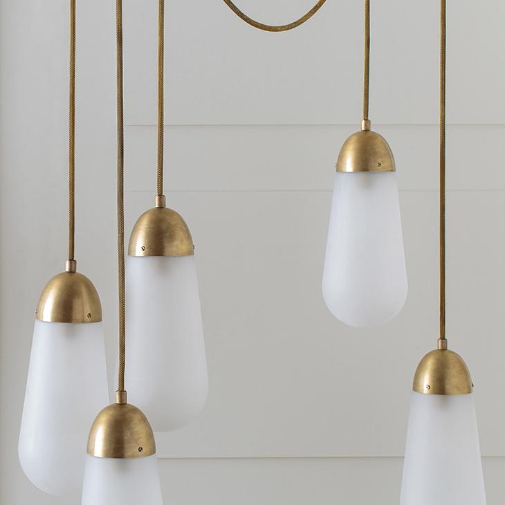 apparatus lariat pendant light installation in a white room