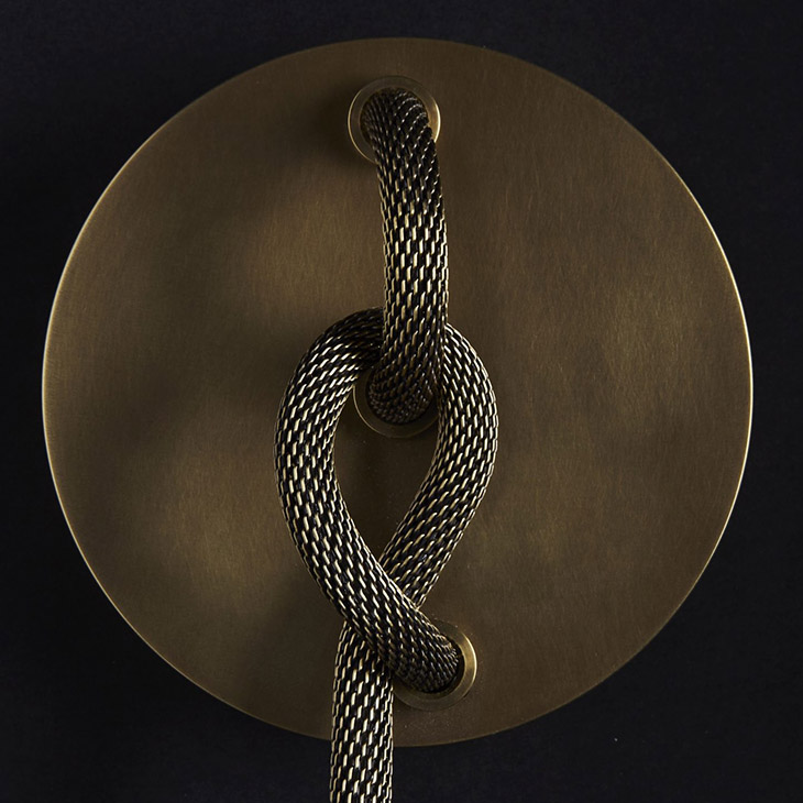 apparatus lariat sconce hardware in aged brass