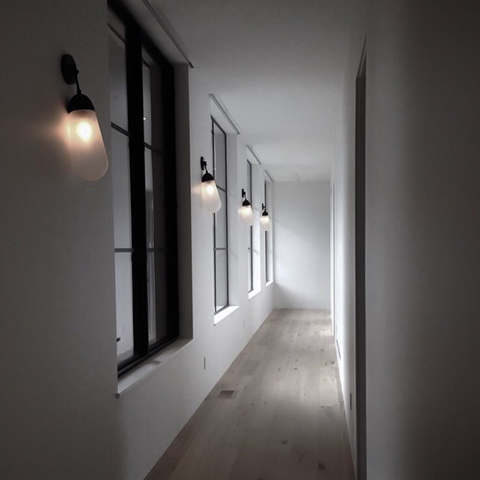 multiple apparatus lariat sconces in a modern hallway